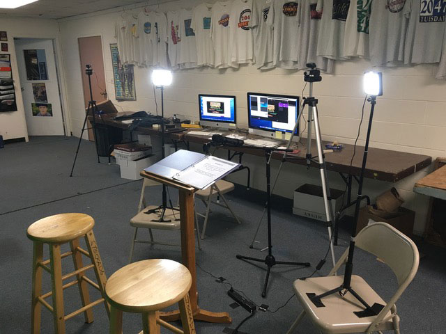 The tech studio – computers, cameras, and (important) lighting.